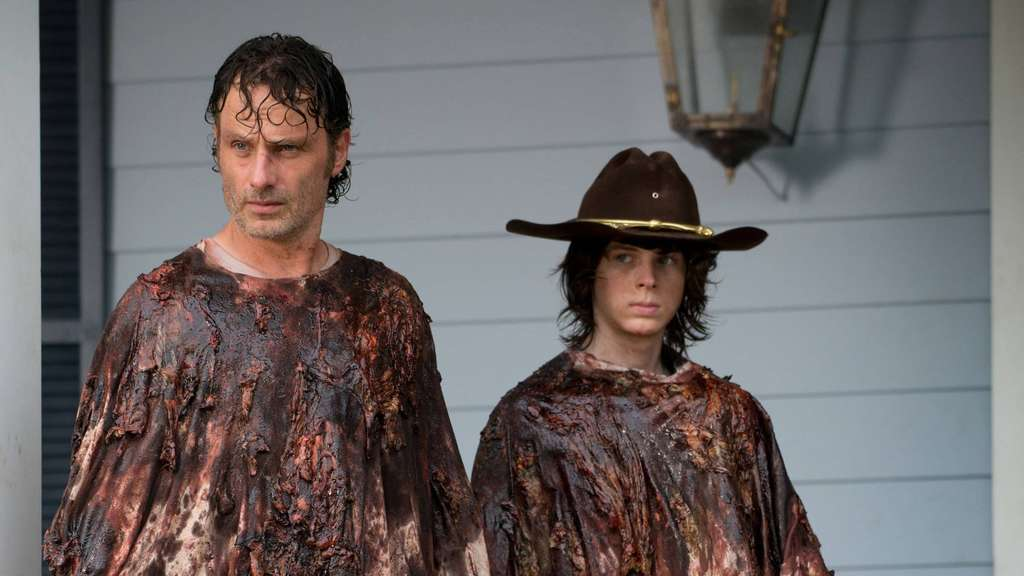 Andrew Lincoln as Rick Grimes and Chandler Riggs as Carl Grimes The Walking Dead Season 6 Episode
